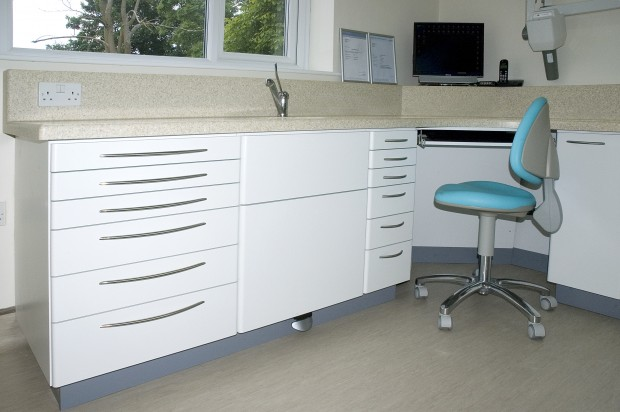 Solid Surface Dental Tops with Laminated Postformed Doors and Drawers.