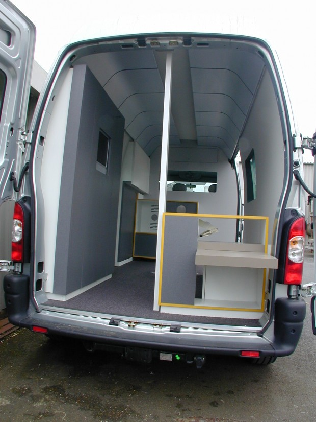 Curved Postformed Head Panels in this van fit-out for Renault.